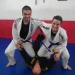 Red Belt Paulo Mauricio Strauch posing with Leo and Hillary at his academy in Rio.